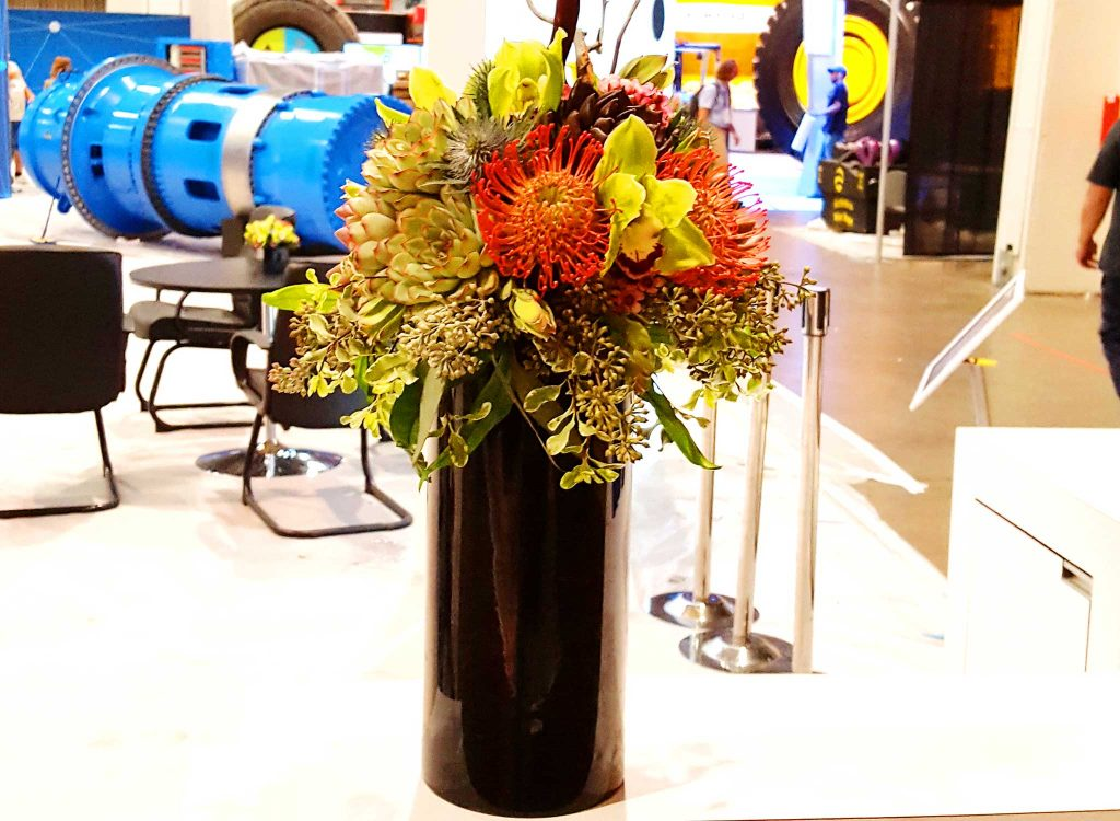 Decorate your event with this energetic flower arrangement.