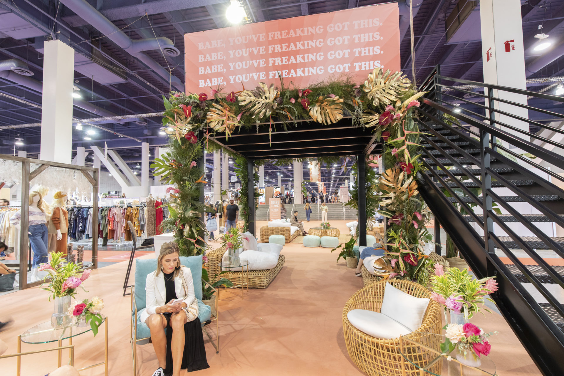 Plant rental arch display at a trade show.
