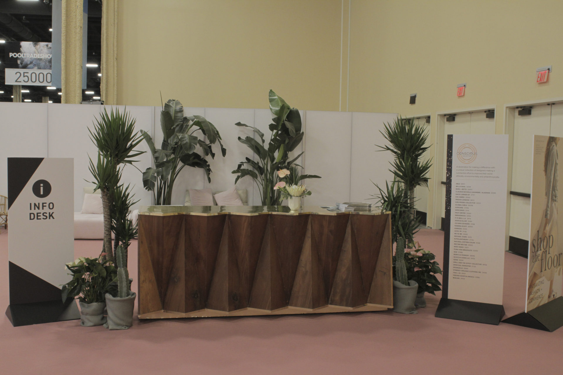 Info desk surrounded by beautiful plants rented for a trade show.